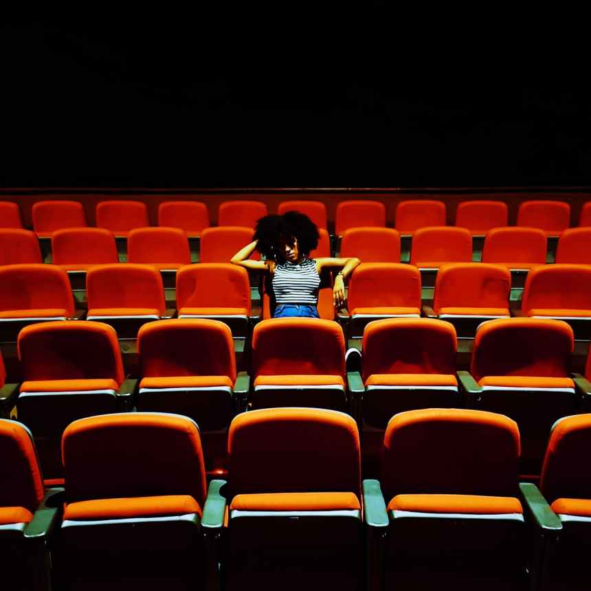 woman sitting inside a theater