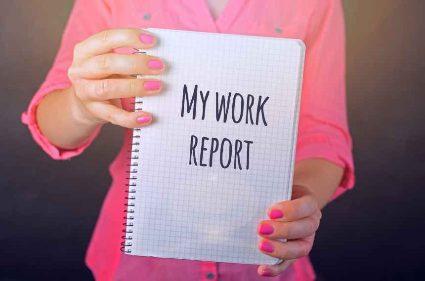 woman in pink long sleeved shirt holding white book with my work report text print