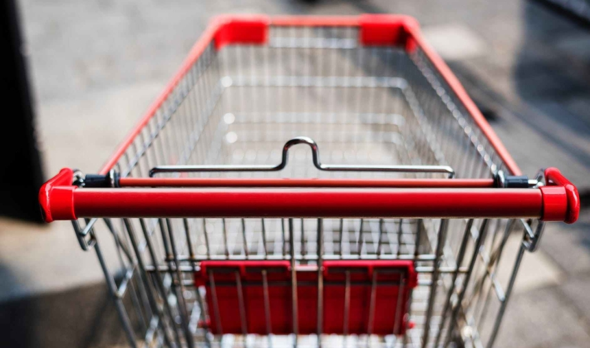 photo of red and silver grocery cart