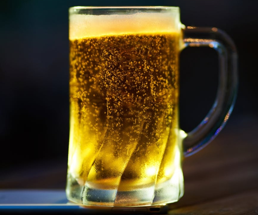 clear glass mug filled with yellow liquid